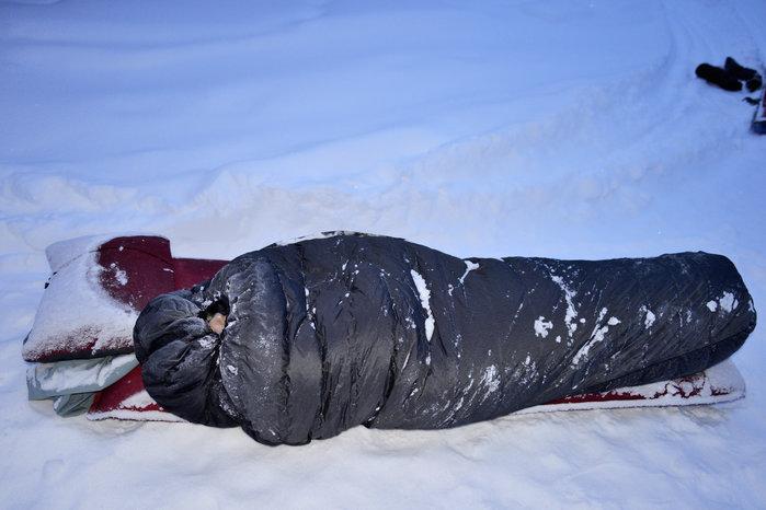Winter camping, sleeping in snow, Alaska.